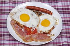 Eggs and Bacon Breakfast on Checked Tablecloth Stock Photos