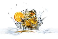 Cocktail glass, falling into clear water, forming a crown splash. - stock illustration