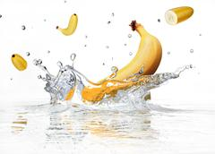 Banana splashing into clear water. Stock Illustration