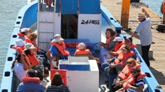 Tourists with life jackets go to the shore excursion in Ensenada, Mexico Stock Footage