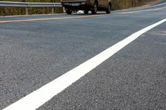 white line on the new road - stock photo