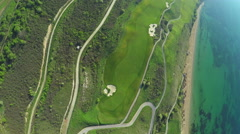 Aerial, Flight over modern golf resort close to sea coast Stock Footage