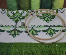 Traditional Ukrainian embroidered towel bright green thread in hoop Stock Photos