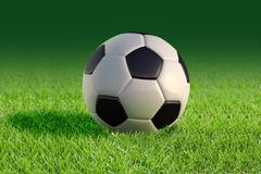 Soccer ball close up on grass lawn. Stock Illustration