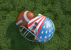 American football helmet decorated as US flag and ball, on the grass. Close u Stock Illustration