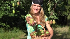 Woman show pear in green garden. Delicious fruit from tree.  4K Stock Footage