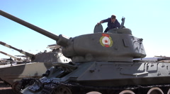 Nellis AFB Nevada Soviet tank man examines technology 4K Stock Footage