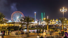 Main square and lake in Global Village with crowd and attractions timelapse in Stock Footage