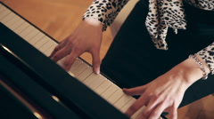 The hands of a woman as she is playing the piano Stock Footage