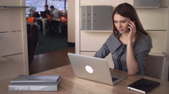 Multitasking  businesswoman at the working place Stock Footage