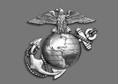 Marine eagle,globe and anchor brass emblem in black and white. Stock Photos