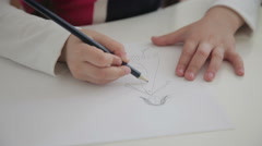 Child draw with pencil Stock Footage