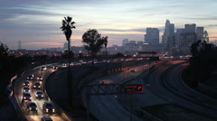 High Definition wide shot of Los Angeles California city traffic at sunset Stock Footage