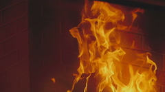 Wooden planks are burning in a fireplace - stock footage