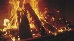 Wooden planks are burning and glowing in fireplace Stock Footage