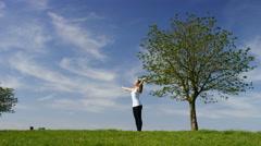 Young woman doing yoga poses, sun salutation and into upward facing dog - stock footage
