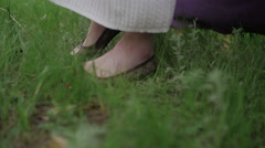 Young Women's Feet Walking on the Grass Stock Footage