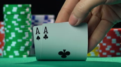 Poker game, player holding winning hand, pair of aces. Successful person, winner Stock Footage