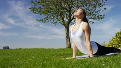Young attractive woman doing yoga in beautiful natural surroundings Stock Footage