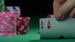Poker player holding one pair of aces, good combination. Chances of winning Stock Footage