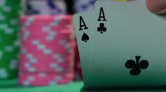 Poker player showing good card combination, one pair of aces in slow motion Stock Footage