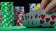 Successful poker player holding royal flush card combination. Leader, winner Stock Footage