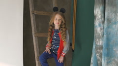 Little girl posing in the studio. Street style Stock Footage