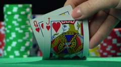 Poker player showing cards, queen and jack of hearts. Unequal love, misalliance Stock Footage