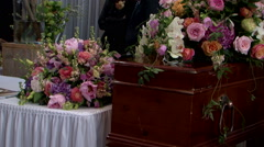 Coffin at funeral flowers at last goodbye ceremony Stock Footage