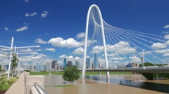 Margaret Hunt Hill Bridge w/ nice sky & clouds over Dallas skyline -real time Stock Footage