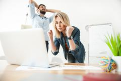 Cheerful two workers are expressing their anticipation - stock photo