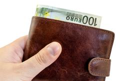 Giving bribe from brown leather wallet with one hundred Euro isolated on whit Stock Photos