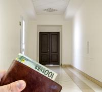 Giving bribe from brown leather wallet with one hundred Euro in white hallway Stock Photos