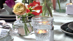 Funeral table candle flowers Stock Footage