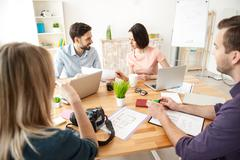 Talented office workers are discussing new project - stock photo