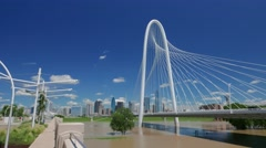 Margaret Hunt Hill & pedestrian bridge time-lapse w/Dallas skyline nice clouds Stock Footage