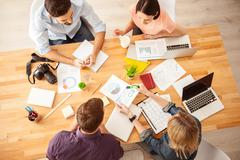 Talented young workers are discussing a project - stock photo