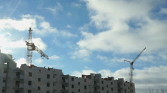 Construction of apartment houses. Crane works Stock Footage