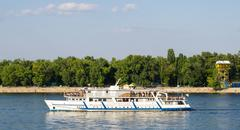 Kiev, Ukraine - August 24, 2015: Pleasure boat with tourists sailing on the r - stock photo