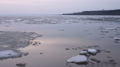 4k Time-lapse evening Ice drift on the river. In the spring the ice floats Stock Footage