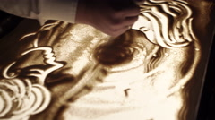 Artist's Hand Draws the Eye in the Sand Stock Footage
