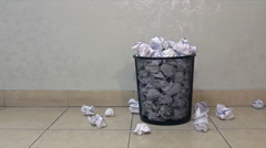 Throwing useless paper into the full waste basket in office Stock Footage