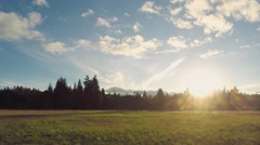 Late Autumn Sunset Over a Pacific Northwest Field Stock Footage