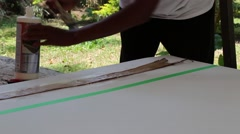 (Close up) Artist gluing banana husks to  canvas - stock footage