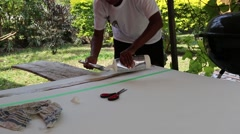 (Close up) Artist gluing banana husks to  canvas (2) - stock footage