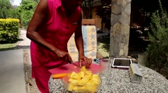 African/America Woman cutting fresh pineapple Stock Footage