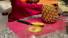 (Time lapse) woman cutting skin off a pineapple Stock Footage