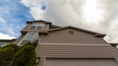 Time lapse of clouds and blue sky over luxury suburban residential home 4k uhd - stock footage
