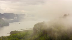 Time lapse of low clouds and fog along Columbia River Gorge in Portland Oregon Stock Footage