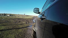 Off-roading with luxury car on a muddy road Stock Footage